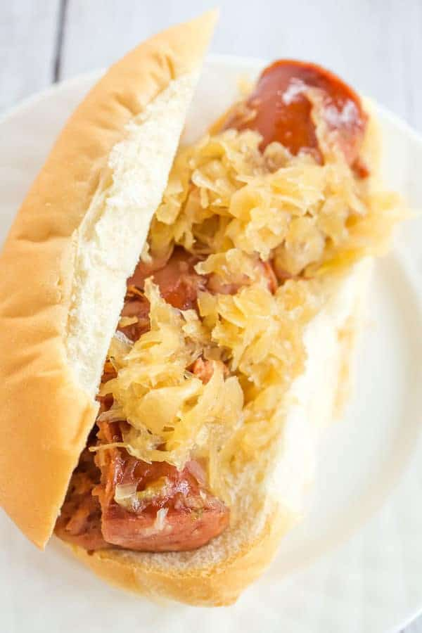 This slow cooker kielbasa and sauerkraut is flavorful and made with just the addition of beer and brown sugar - easy, delicious and perfect for parties!
