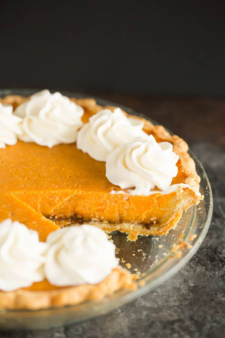 Sweet potato pie with a slice removed.