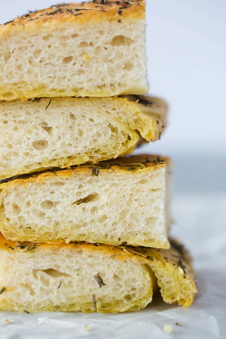 A stack of pieces of focaccia bread.