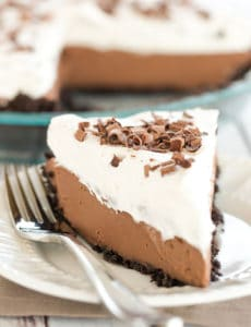 Chocolate Cream Pie - A classic (from scratch!) recipe with Oreo cookie crust, a chocolate pastry cream filling and fresh whipped cream.