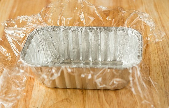 Homemade American Cheese: Lining pan with plastic wrap