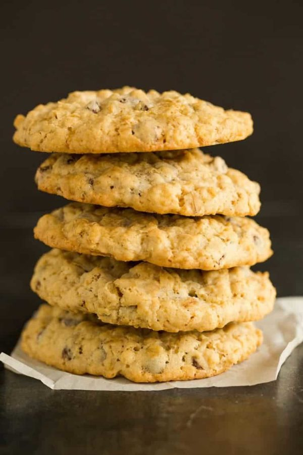 A big stack of five oatmeal chocolate chip cookies.