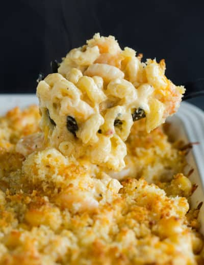 Scooping up a big helping of Cajun shrimp macaroni and cheese.
