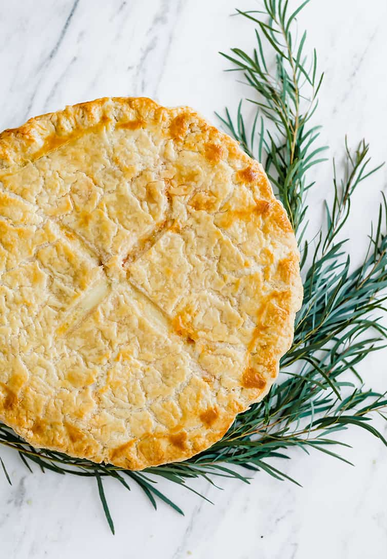 An overhead shot of baked Italian Easter Pie, garnished with rosemary.