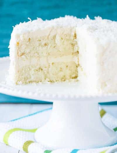Coconut-Vanilla Bean Cake with Coconut Meringue Buttercream Frosting - A super moist coconut-packed layer cake and that frosting is a DREAM!