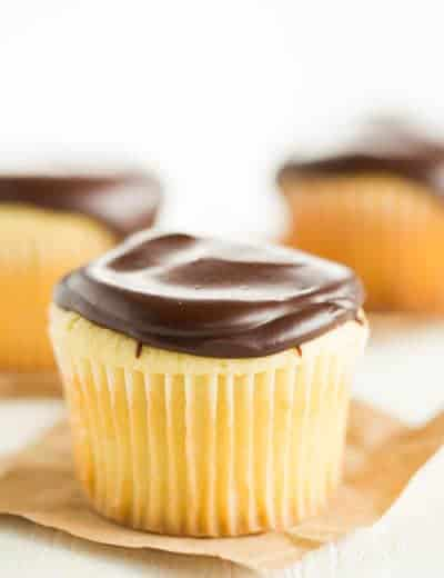 Boston Cream Cupcakes - Vanilla cupcakes filled with pastry cream and topped with chocolate ganache.
