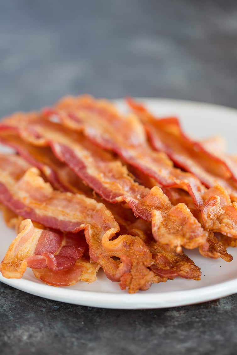 A plate piled high with oven baked bacon.