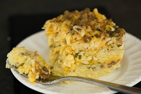 Slow Cooker Sausage, Hash Brown & Cheddar Breakfast Casserole by @browneyedbaker :: www.browneyedbaker.com