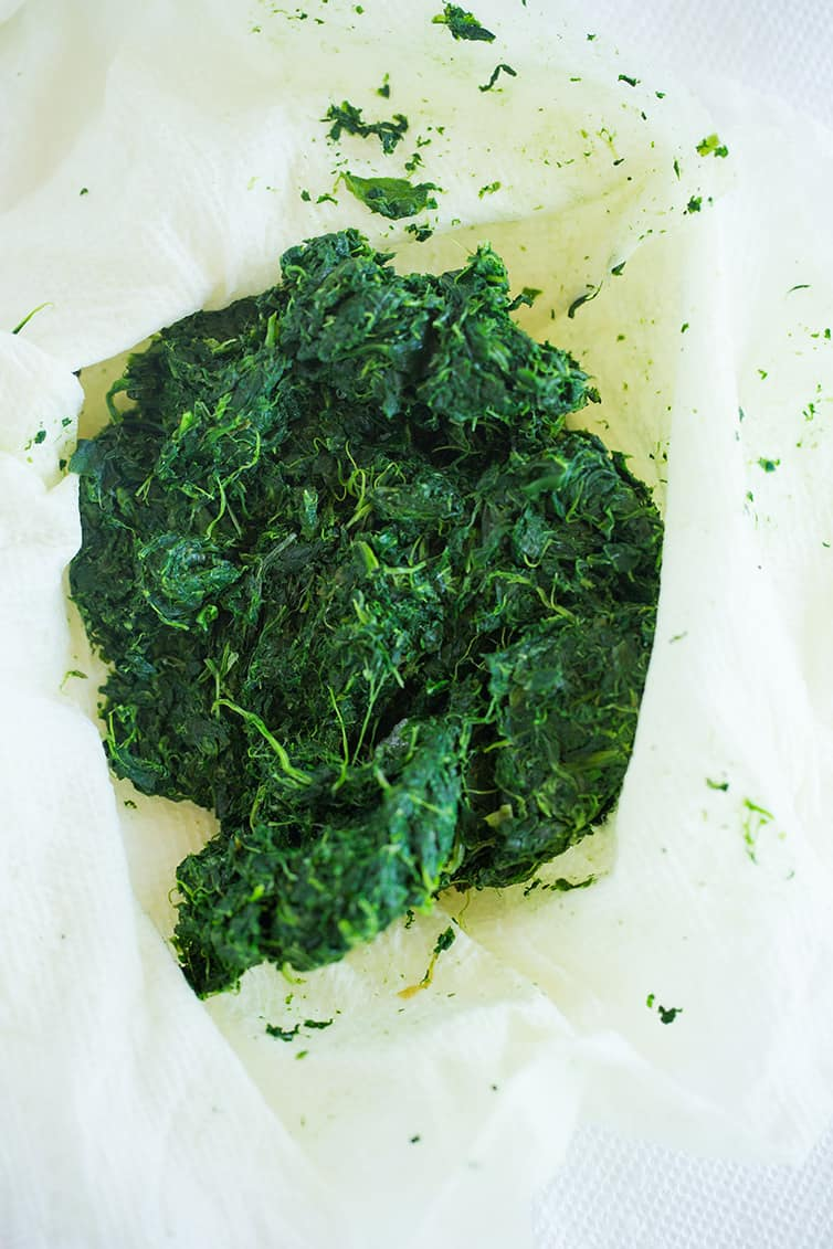 Thawed and drained chopped spinach in paper towel.