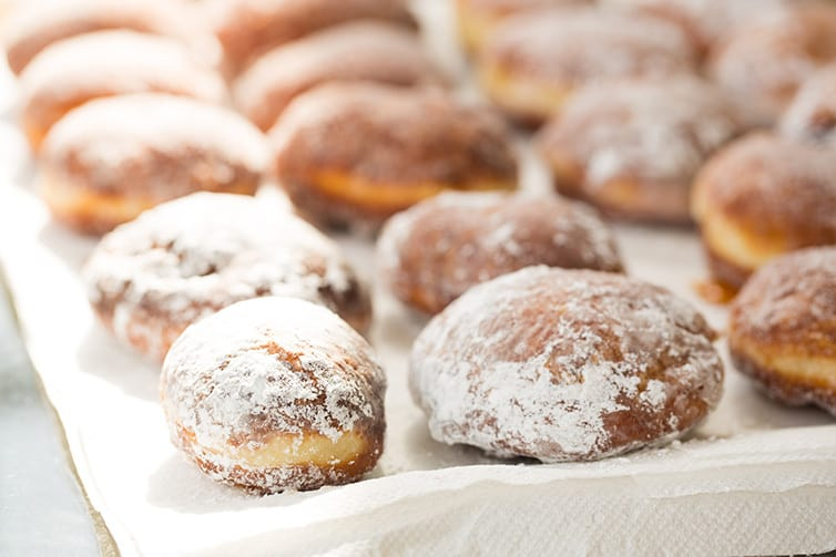 Freshly fried and sugared paczki.
