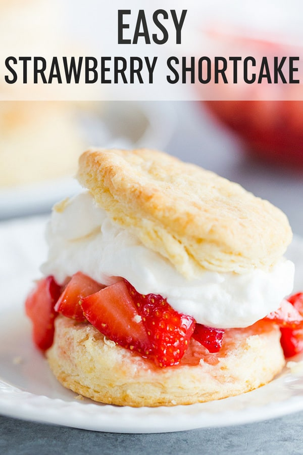 Easy Strawberry Shortcake :: Homemade buttermilk biscuits are topped with fresh, macerated strawberries, and homemade whipped cream. A summer staple! #browneyedbaker #strawberryshortcake #strawberries #summerdesserts #whippedcream #biscuits #homemadebiscuits