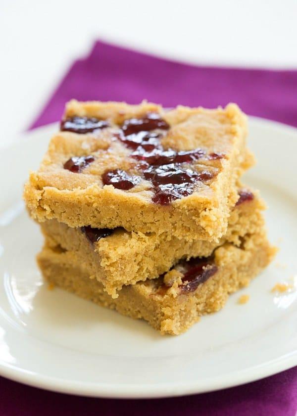 Peanut Butter & Jelly Cookie Bars | browneyedbaker.com #recipe