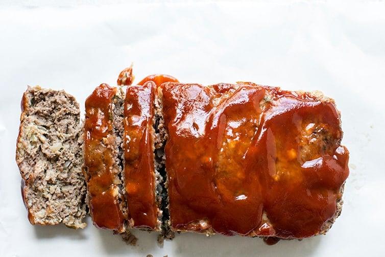 Baked, glazed and sliced meatloaf.