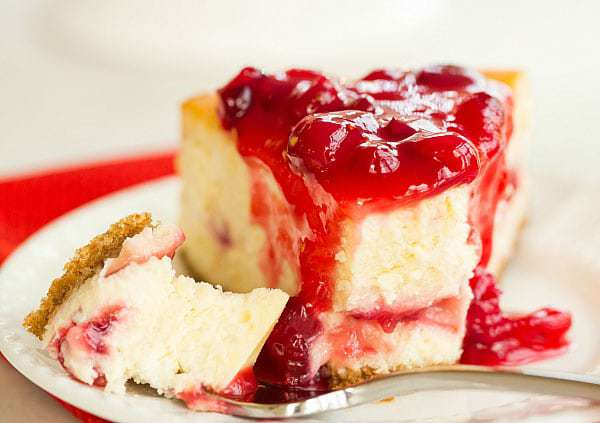 Cranberry-Eggnog Cheesecake - The perfect dessert to take you from Thanksgiving right on through Christmas! | browneyedbaker.com