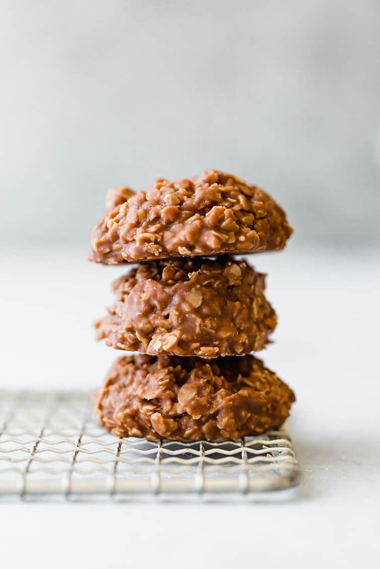 A stack of three no bake cookies on a cooling rack.