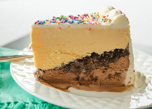 Copycat Dairy Queen Ice Cream Cake - Layers of chocolate ice cream, hot fudge, chocolate crunchies and vanilla ice cream! | browneyedbaker.com