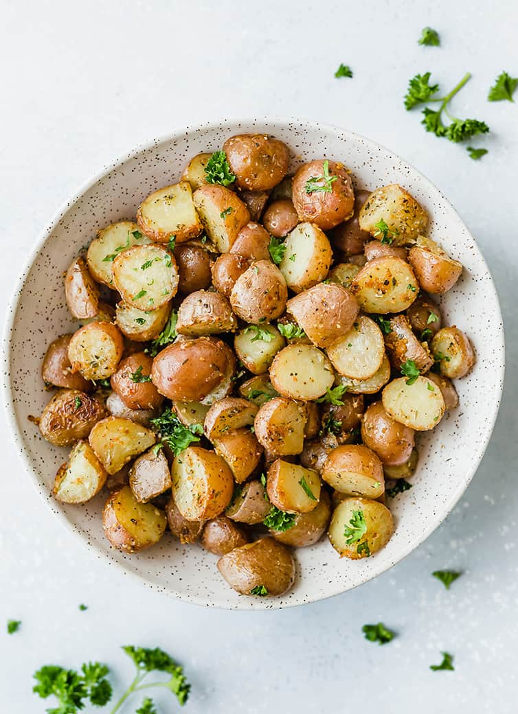 An overhead shot of a bowl of roasted red potatoes.