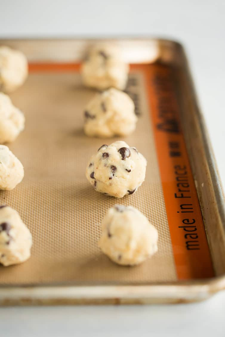 Balls of cookie dough on a baking sheet.