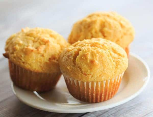 Cornbread Muffins made with tons of cornmeal are fluffy and moist - perfect with a bowl of chili!   https://www.browneyedbaker.com/cornbread-muffins/