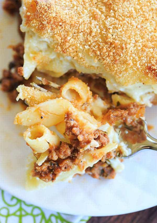 A classic pastitsio recipe - layers of ziti pasta with a beef and lamb sauce, bechamel and loads of cheese! | https://www.browneyedbaker.com/pastitsio-recipe/