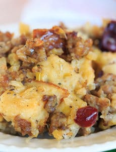 Sausage, Apple & Sage Stuffing made with Challah bread. | https://www.browneyedbaker.com/sausage-apple-sage-stuffing/