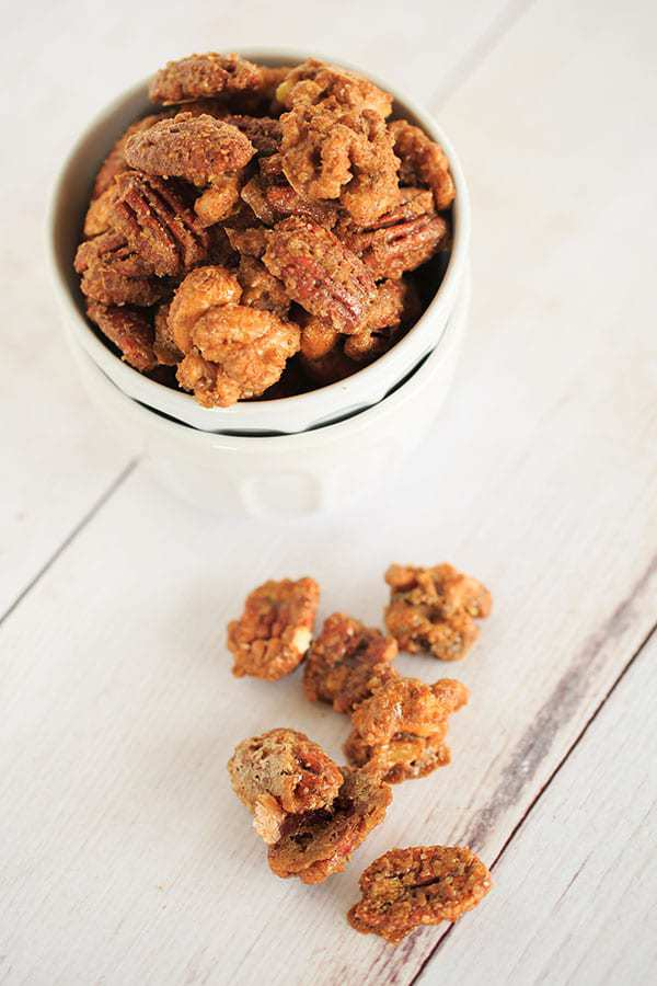 Sugar and Spiced Candied Nuts - These sweet and spicy candied nuts are sweet with a punch of cinnamon and a hint of spice. Perfect for holiday cocktail parties or hostess gifts! | https://www.browneyedbaker.com/sugar-and-spice-candied-nuts/
