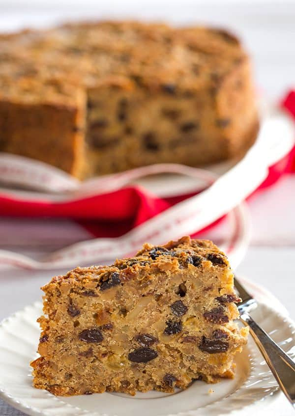 Christmas Cake - A wonderfully dense and moist fruit cake loaded with rum-soaked fruit! | https://www.browneyedbaker.com/christmas-cake/