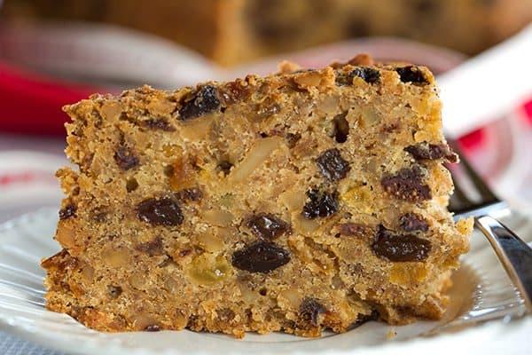 Christmas Cake - A wonderfully dense and moist fruit cake loaded with rum-soaked fruit! | https://www.browneyedbaker.com/christmas-cake/