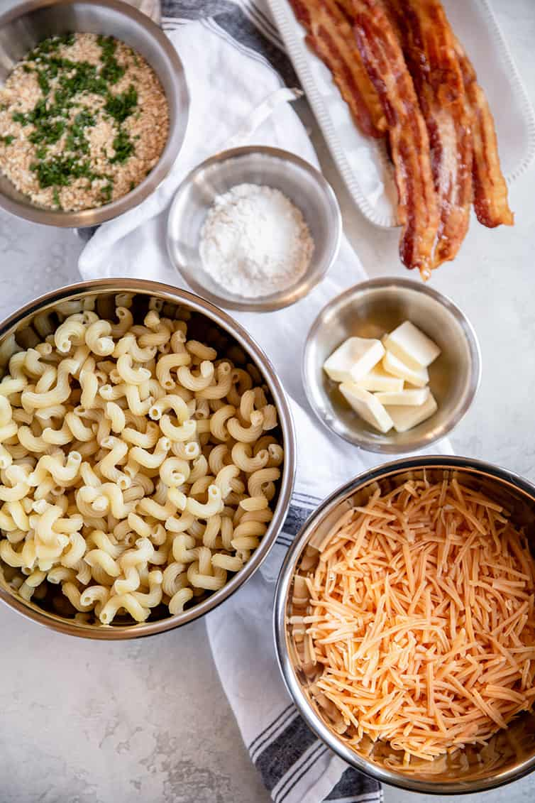 Ingredients for baked mac and cheese prepped in bowls.