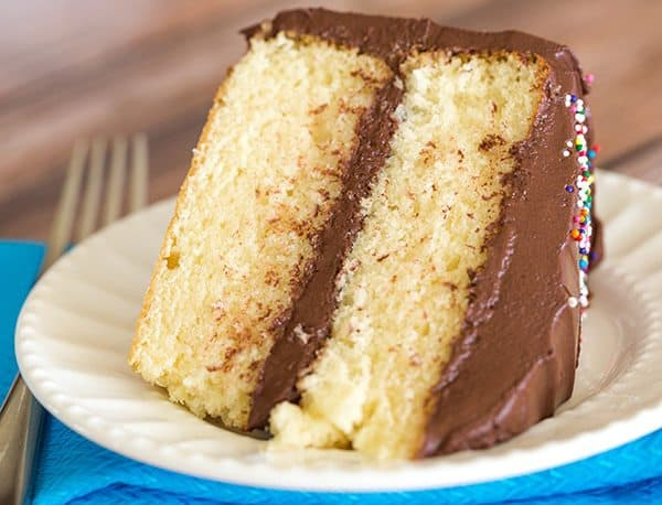 An easy, homemade yellow cake recipe that's buttery and moist, filled and frosted with the best chocolate frosting!