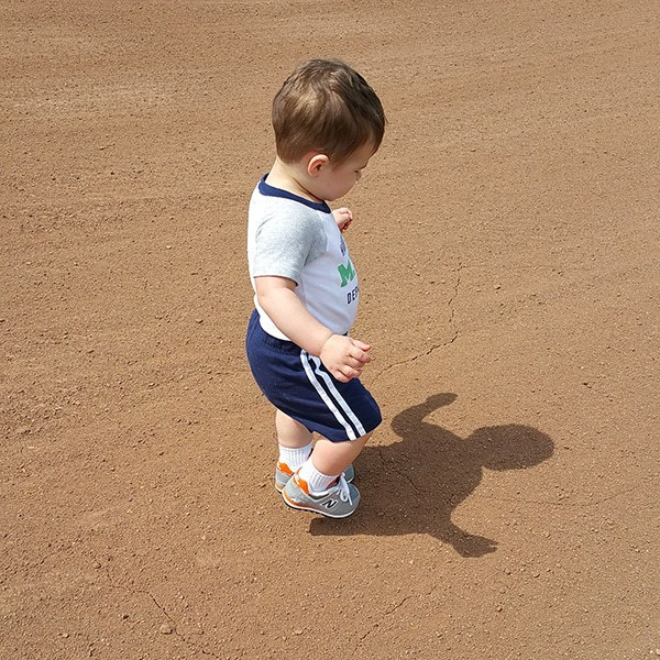 Joseph running around the baseball field