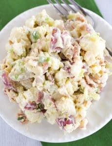 An overhead view of a plate of potato salad.