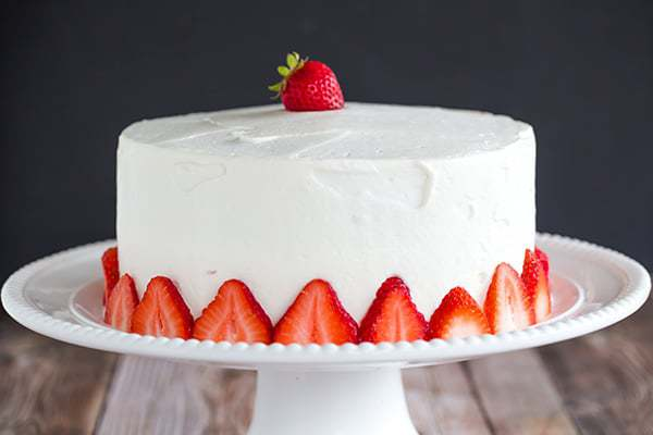 Strawberry Poke Cake - A two-layer beauty with the most amazing fresh sweet whipped cream. A perfect summer celebration cake!