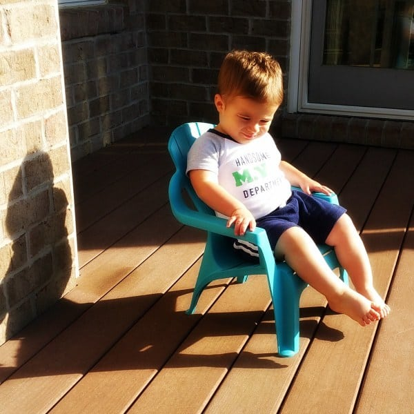 Joseph lounging on the deck in his little adirondack chair.