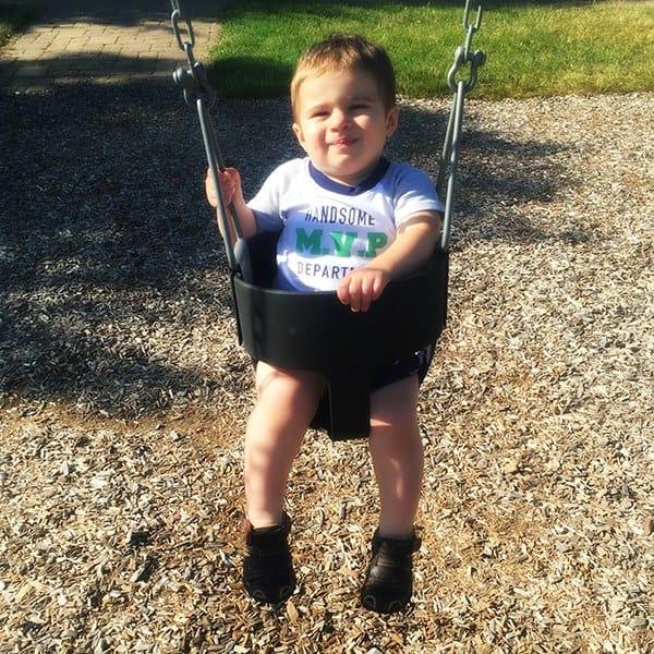Joseph adores the swing!