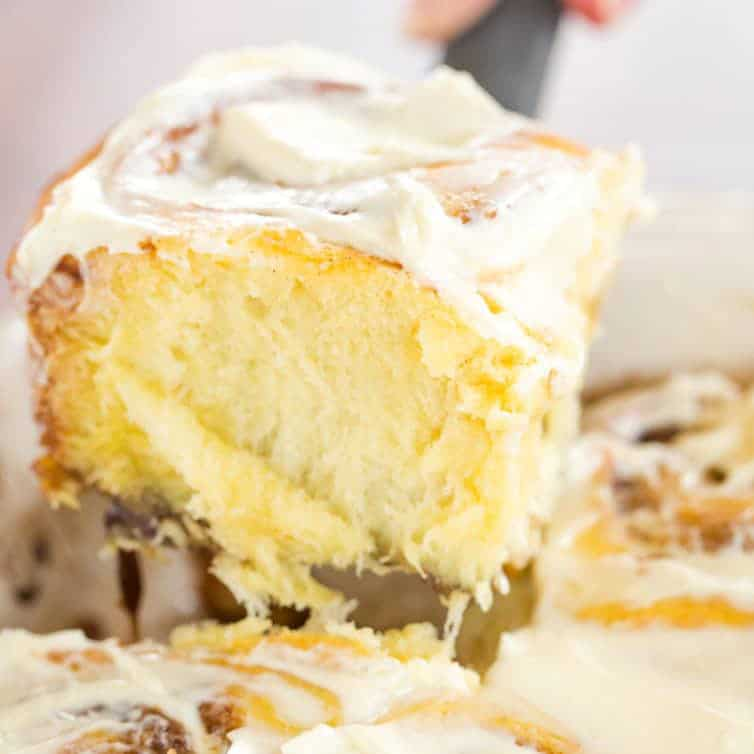 Soft and fluffy cinnamon rolls with tons of buttery-cinnamon filling and a just-sweet-enough cream cheese glaze on top. Perfect company breakfast!