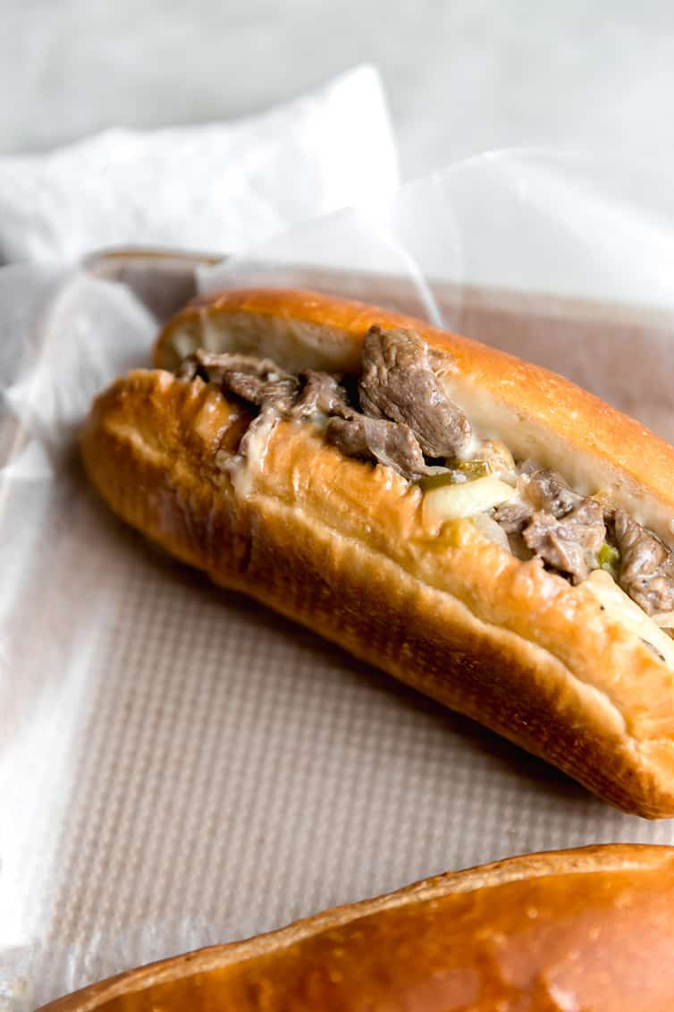 A Philly cheese steak sandwich on its side.