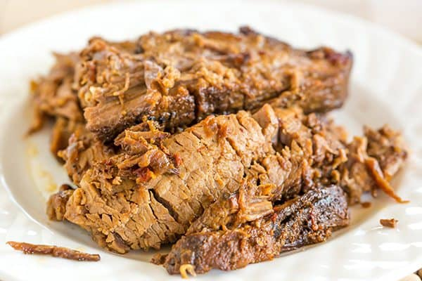 This slow cooker beef brisket is incredibly easy, cooks itself, and full of flavor thanks to the simple homemade barbecue sauce!