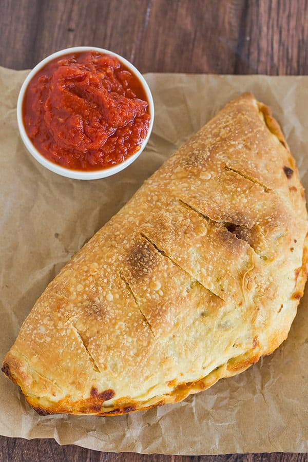 Simple, classic calzones made from an easy pizza dough and with an unlimited assortment of filling possibilities!