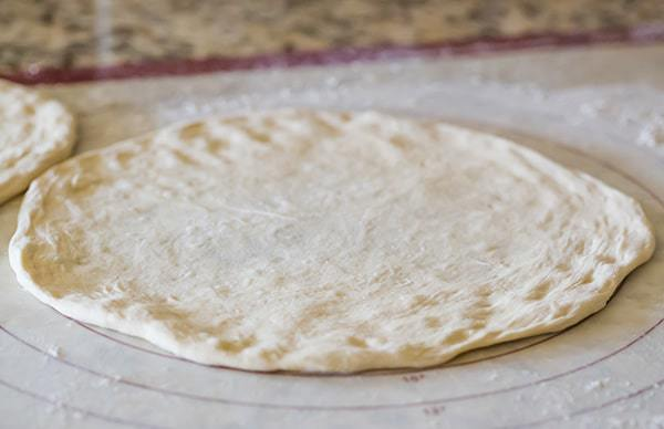 This Neapolitan pizza crust is thin, crispy and has the most amazing flavor. My homemade pizza-making is forever changed!