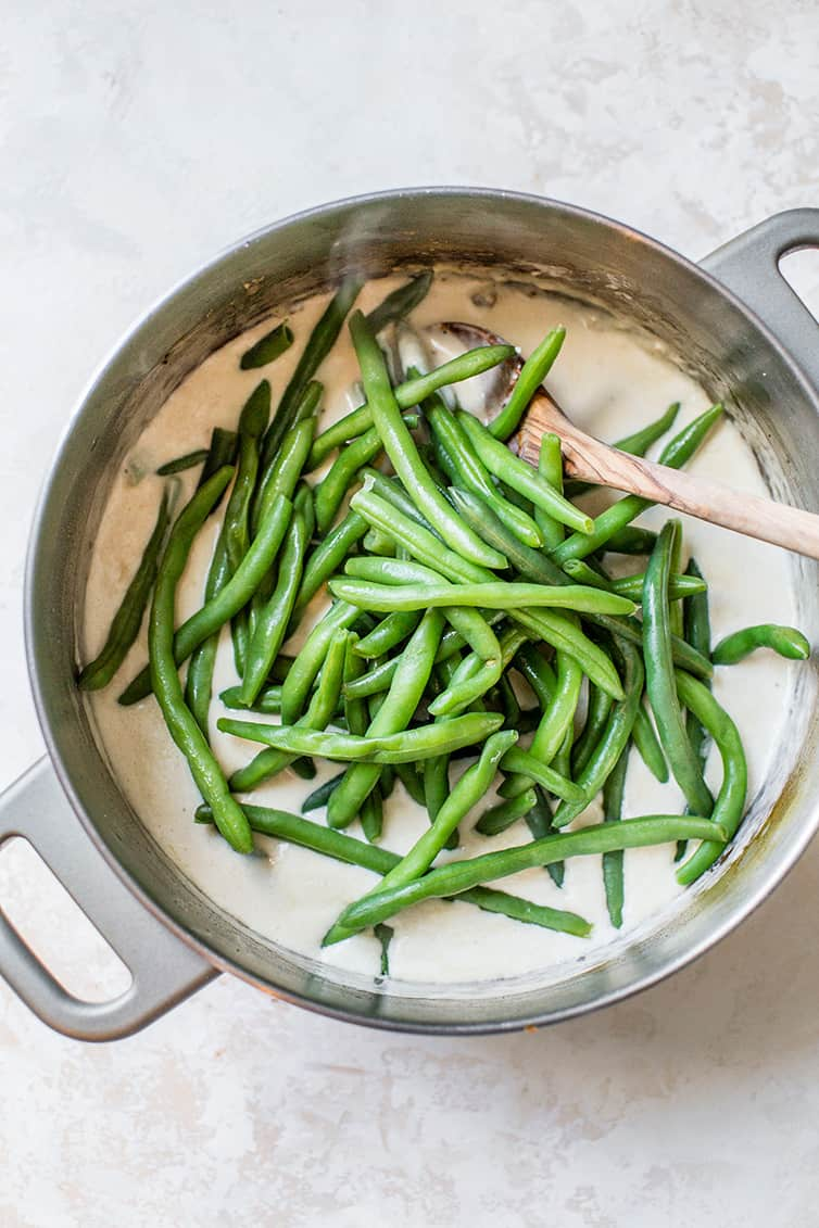 Green beans in a pot of homemade mushroom sauce.
