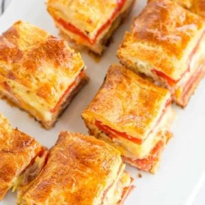 This easy antipasto appetizer bake features layers of Italian meats and cheese, sandwiched between layers of crescent dough. Great for parties!