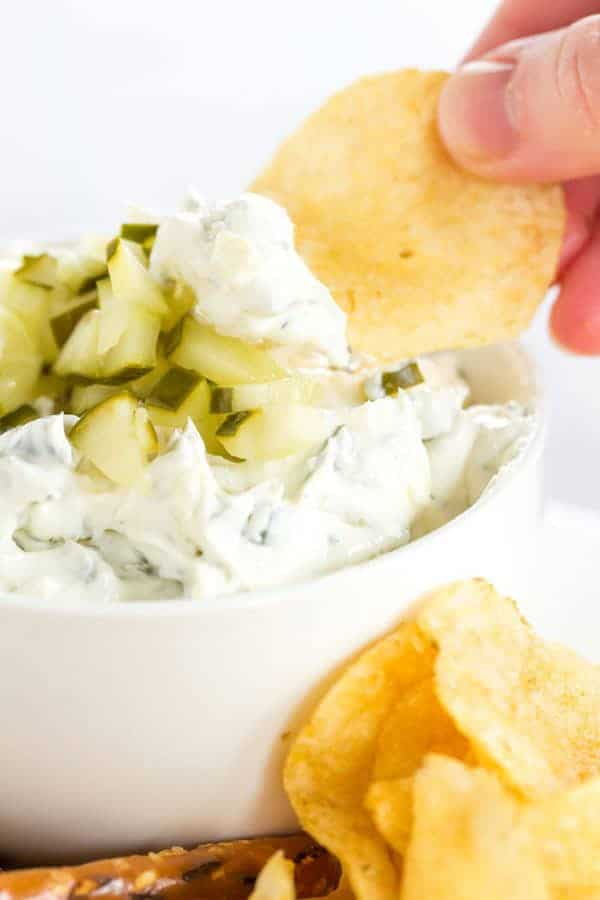 Dill pickle dip is a must for any pickle fan! Loads of pickle and dill flavor and it's perfect for dipping pretzels, chips, crackers, or veggies.