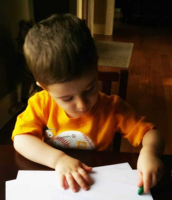 Joseph coloring at his table.