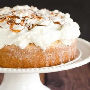 Caramel Tres Leches Cake topped with fresh whipped cream.