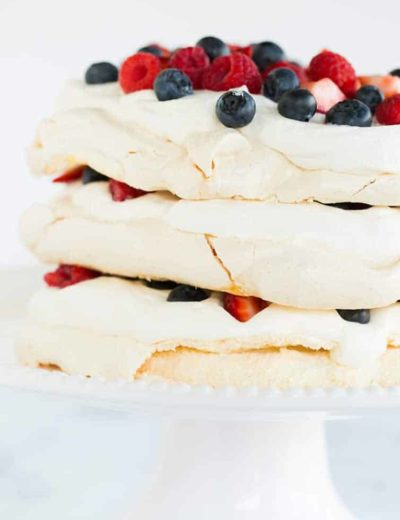 A closeup of pavlova layer cake on a cake stand.