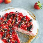 A strawberry-vanilla ice cream pie with a sugar cone and pretzel crust.