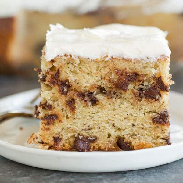Banana-Chocolate Chip Snack Cake - Super easy, fluffy and moist, loaded with chocolate chips, and topped with cream cheese frosting.