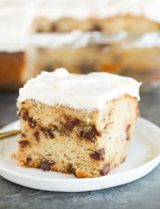 A beautiful slice of Banana-Chocolate Chip Snack Cake slathered with cream cheese frosting.