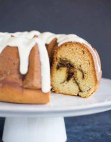 A beautiful bundt coffee cake with cinnamon swirls and cream cheese icing.